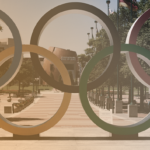 Olympic rings at the entrance to an athletic center.